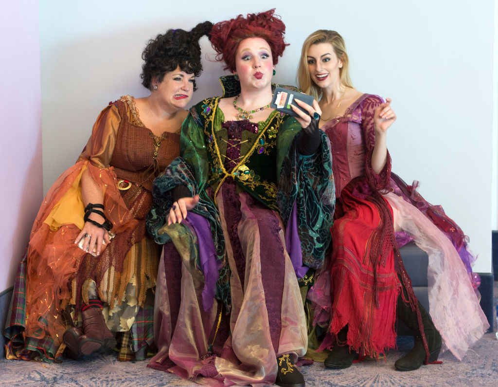 three women dressed as the sanderson sisters from hocus pocus