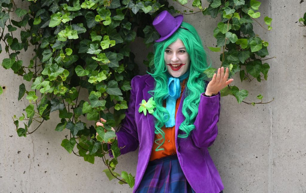 a woman dressed as the joker from batman