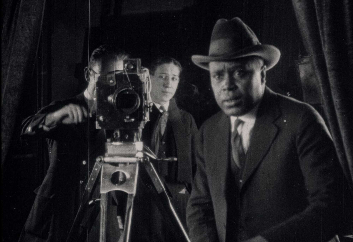 A director and cameramen are seen in a black-and-white photograph.