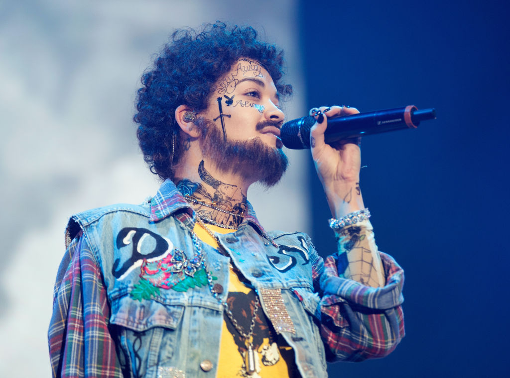 rita ora dressed as post malone while performing on stage