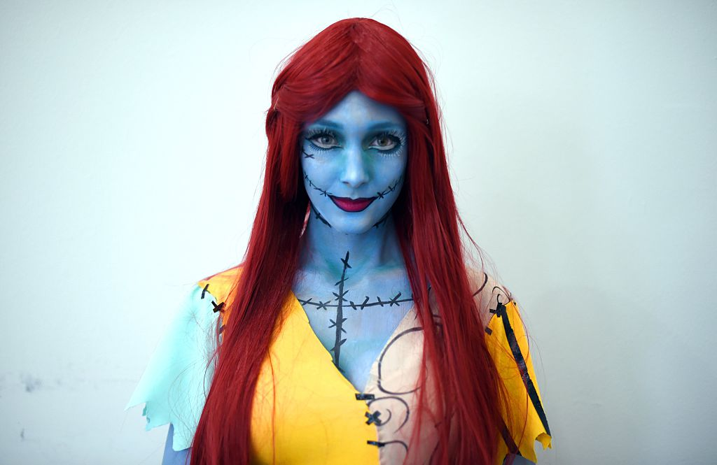 a woman dressed as sally from the nightmare before christmas