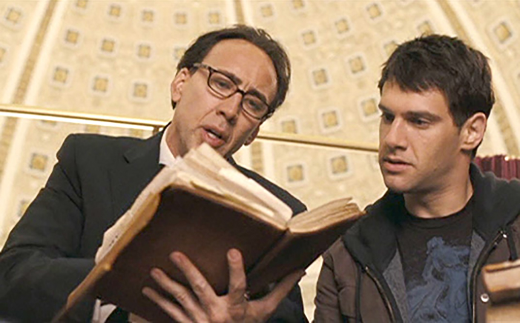 Cage reading the Book of Secrets