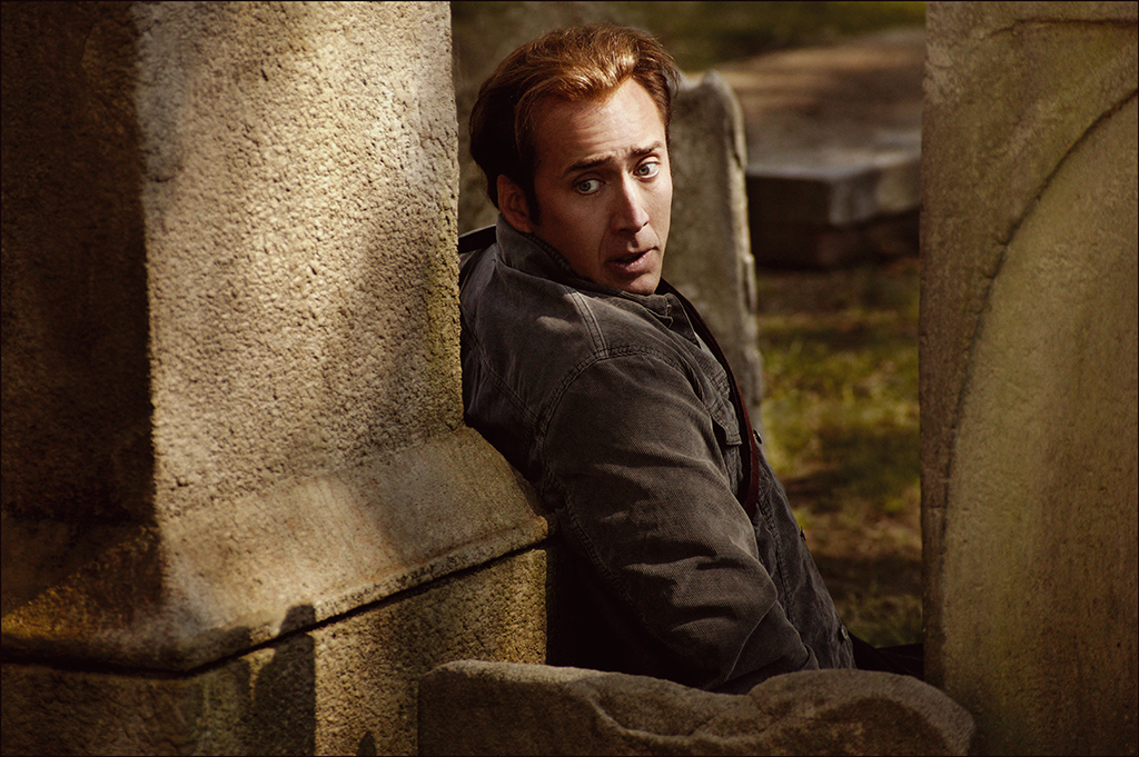 Nicholas Cage behind wall