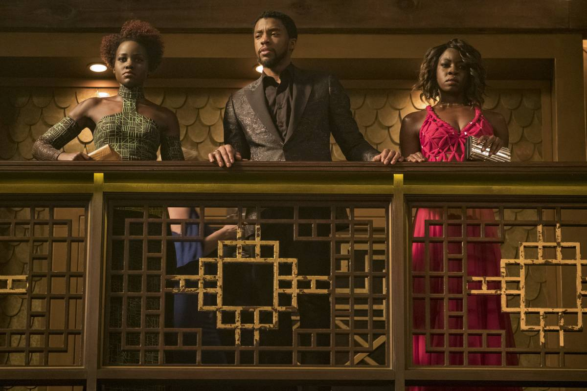 Okoye, T'Challa, And Nakia Are Dressed In Pan-African Flag Colors