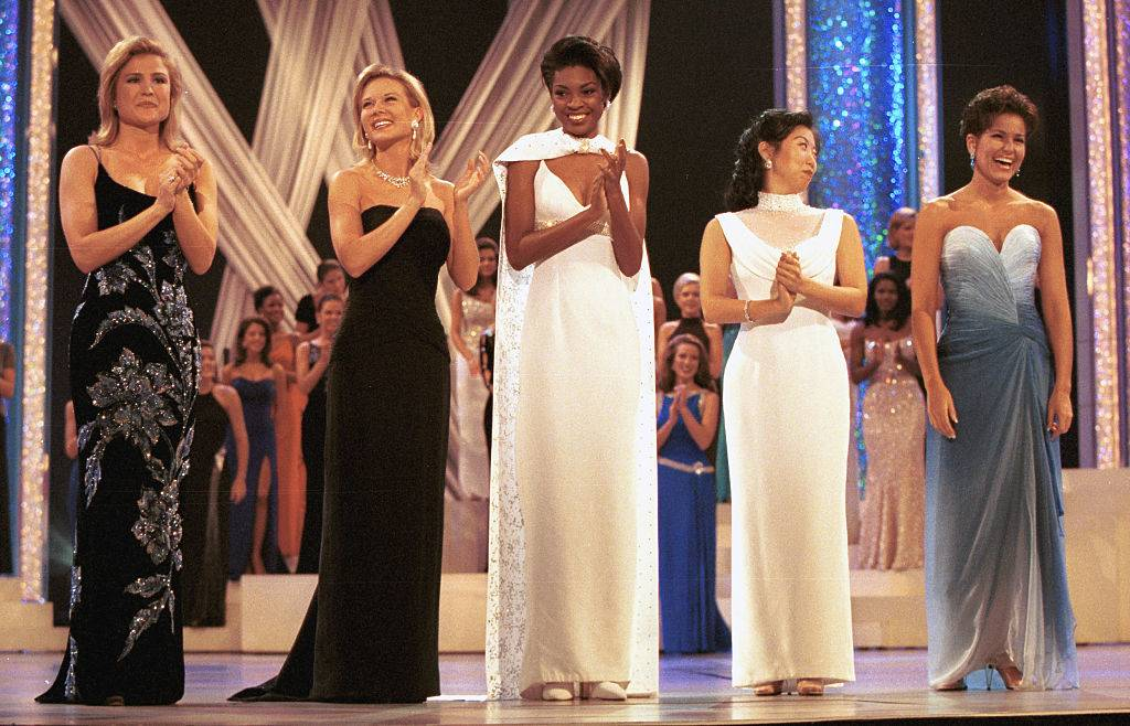 women in long gowns competing in a pageant