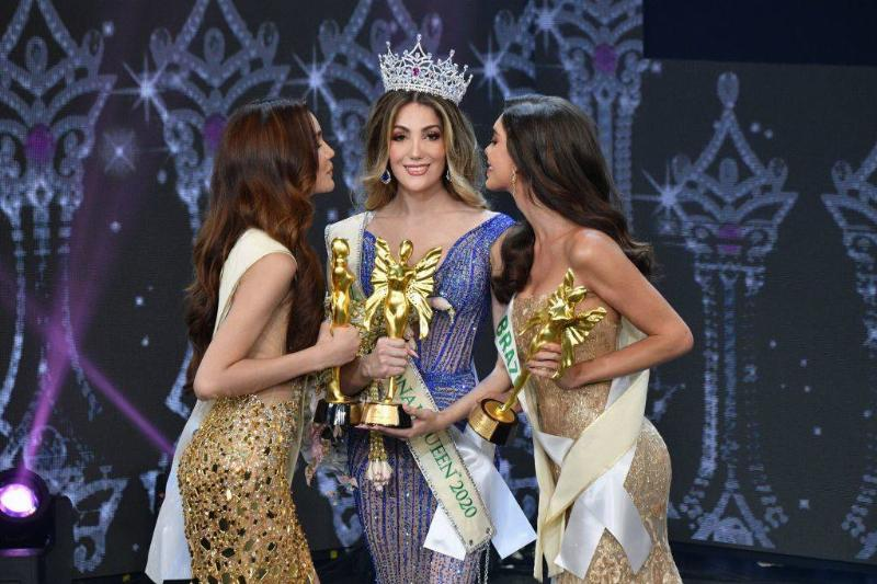 three women holding trophies after competing in a beauty pageant