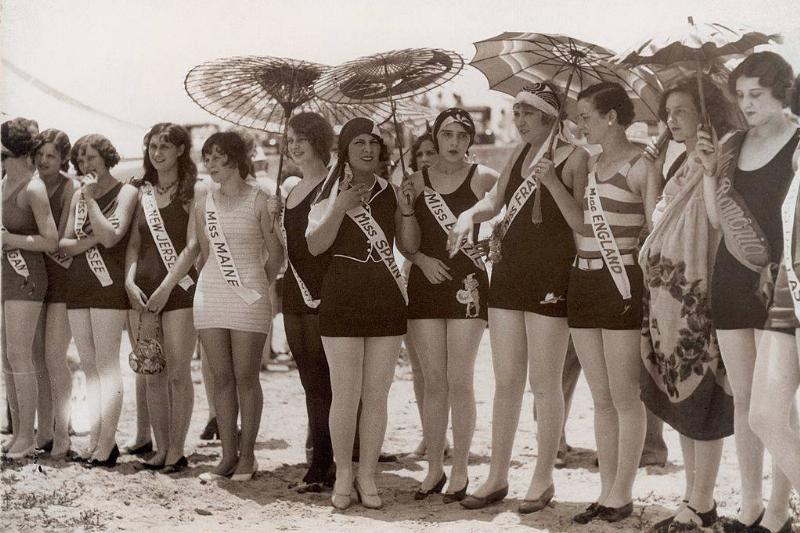 women competing in a pageant on the beach in the early 20th century