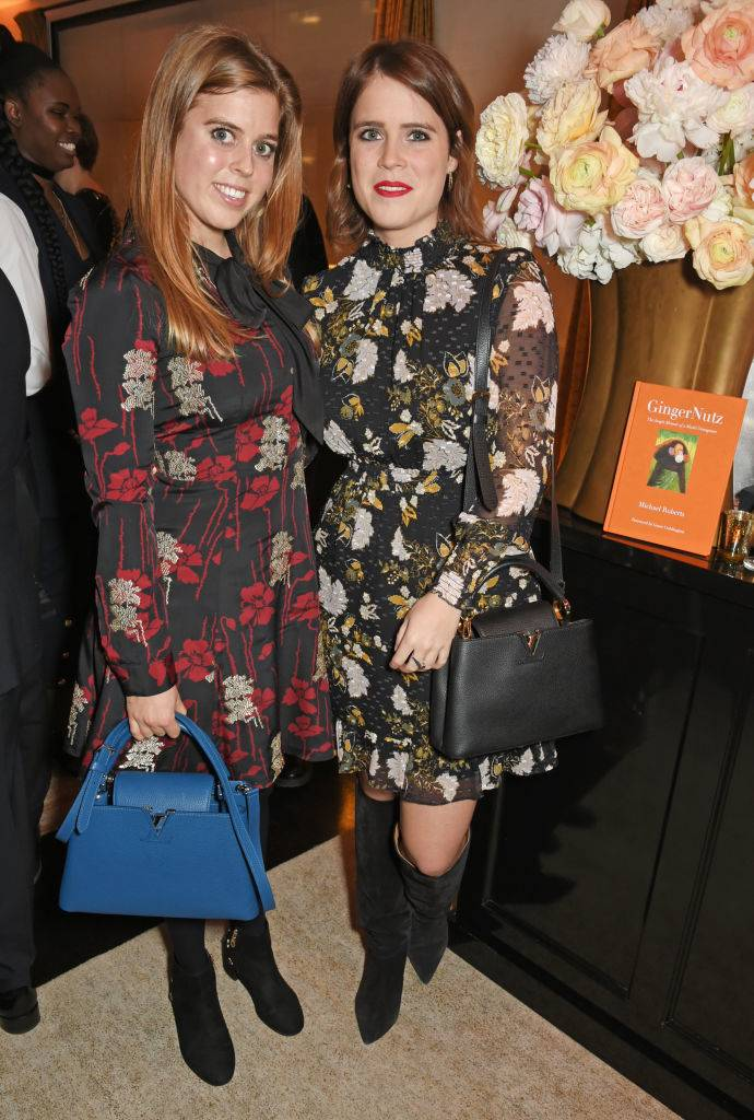 Princess Beatrice of York (L) and Princess Eugenie of York attend Louis Vuittons Celebration