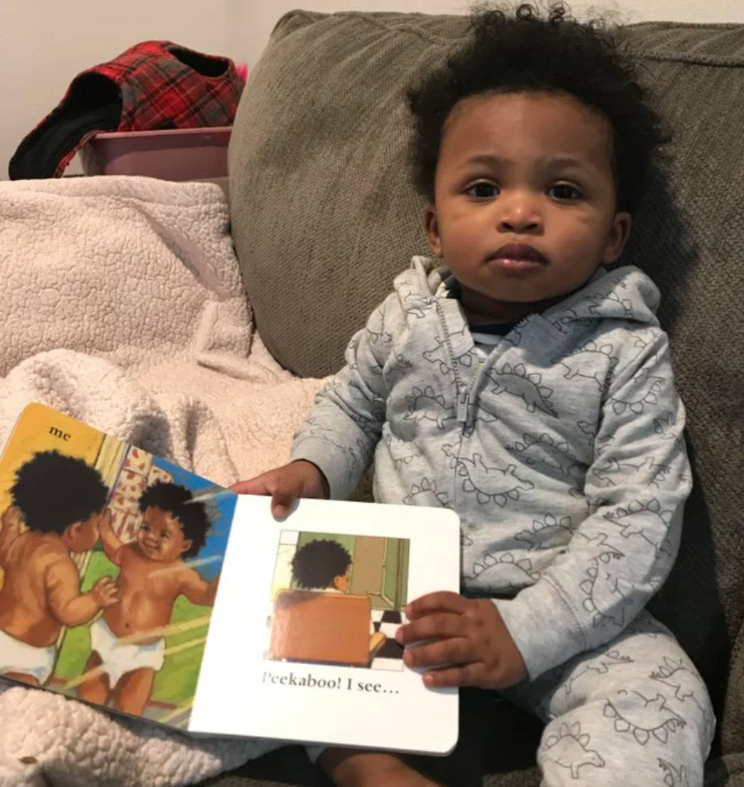 boy reading book looks just like character pictured inside