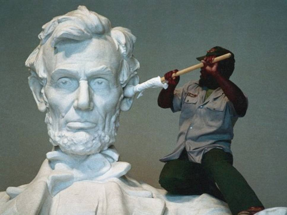 man cleaning lincoln memorial statue looks like he's q-tipping his ear