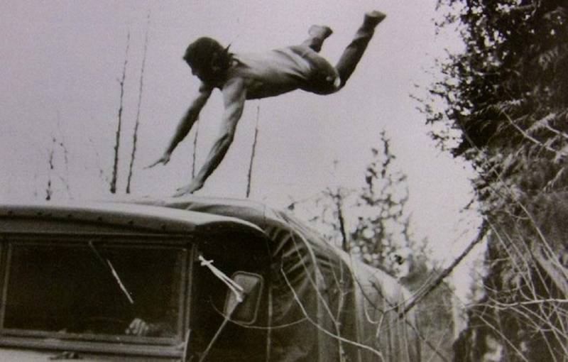 Stallone jumping onto a bus