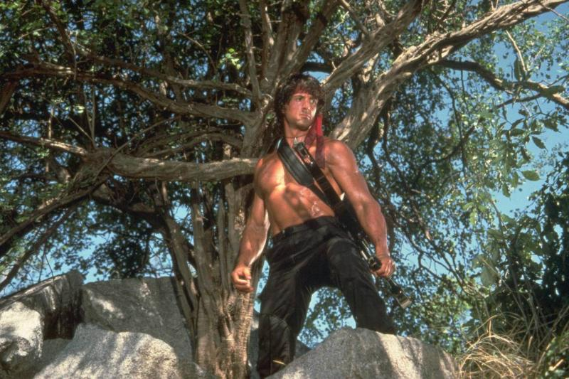 Rambo standing on a rock