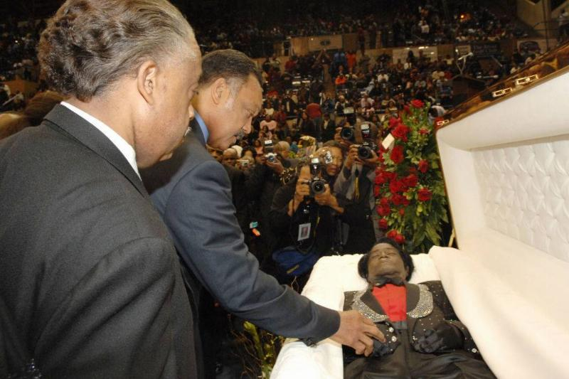 Rev. Al Sharpton and Rev. Jesse Jackson pay their respects to the late James Brown