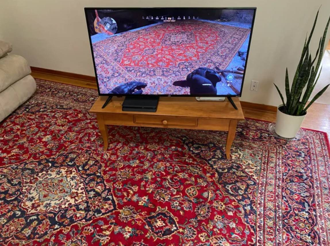 person finds a rug identical to the one his floor in a video game