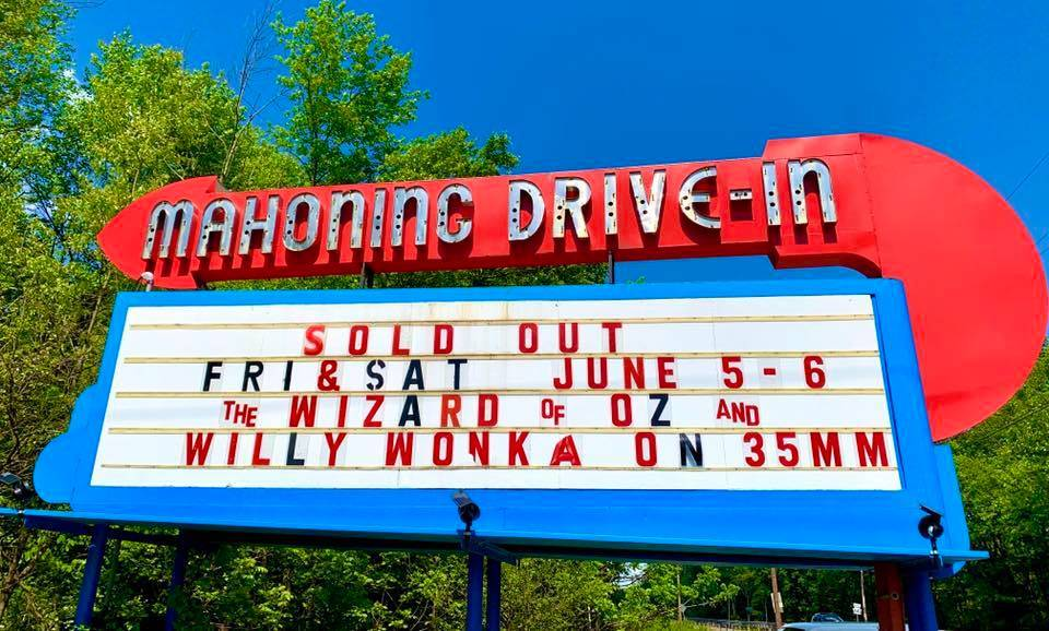a mahoning drive-in sign showing sold out movies
