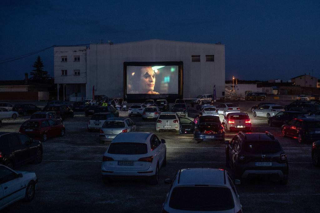 a drive-in movie theater showing Joker