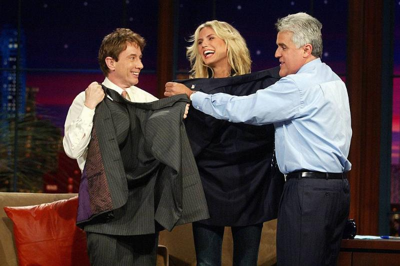 heidi klum, martin short, and jay leno holding up suit jackets