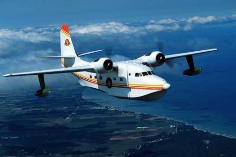 Jimmy Buffett's Grumman HU-16 Albatross flies over the water.