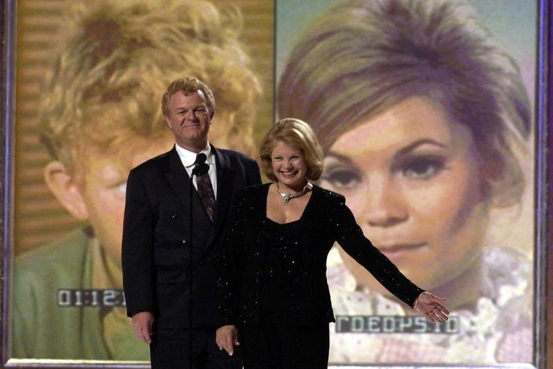 The surviving cast members of Family Affair, Johnny Whitaker and Kathy Garver, appear at a reunion.
