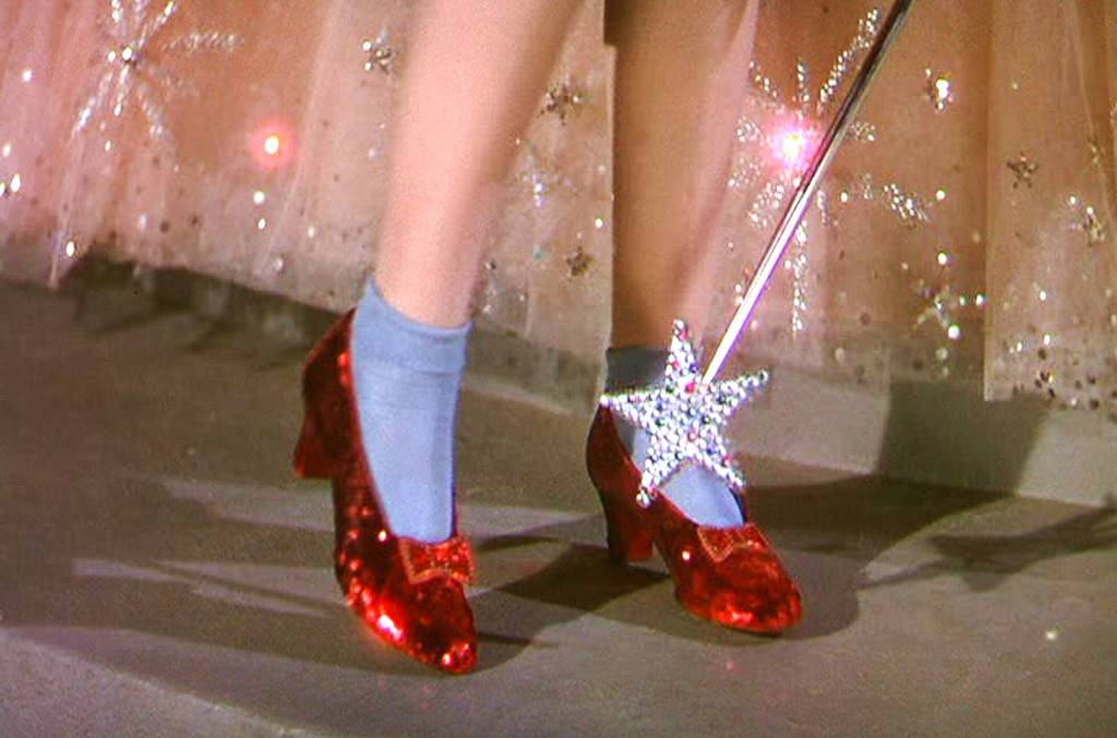 Dorothy Clicking Her Ruby Slippers In The Wizard Of Oz