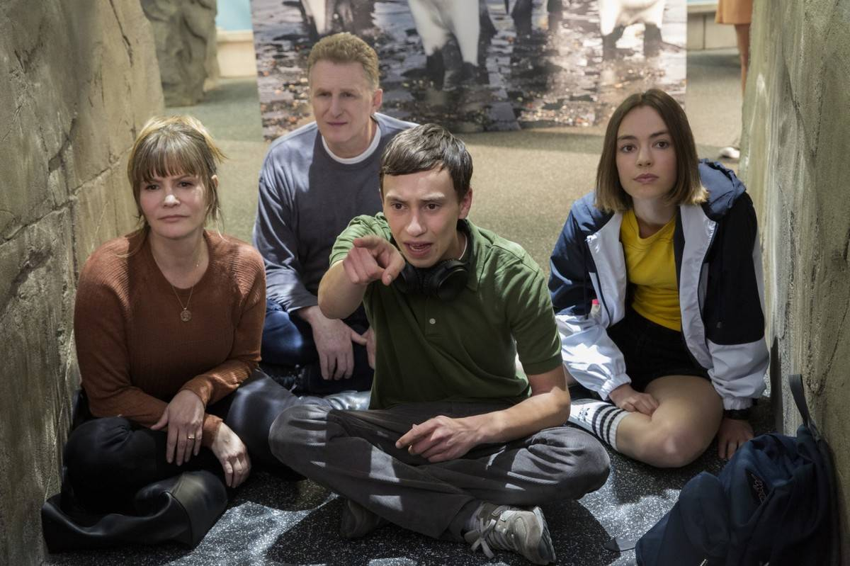 cast of atypical sitting in an aquarium