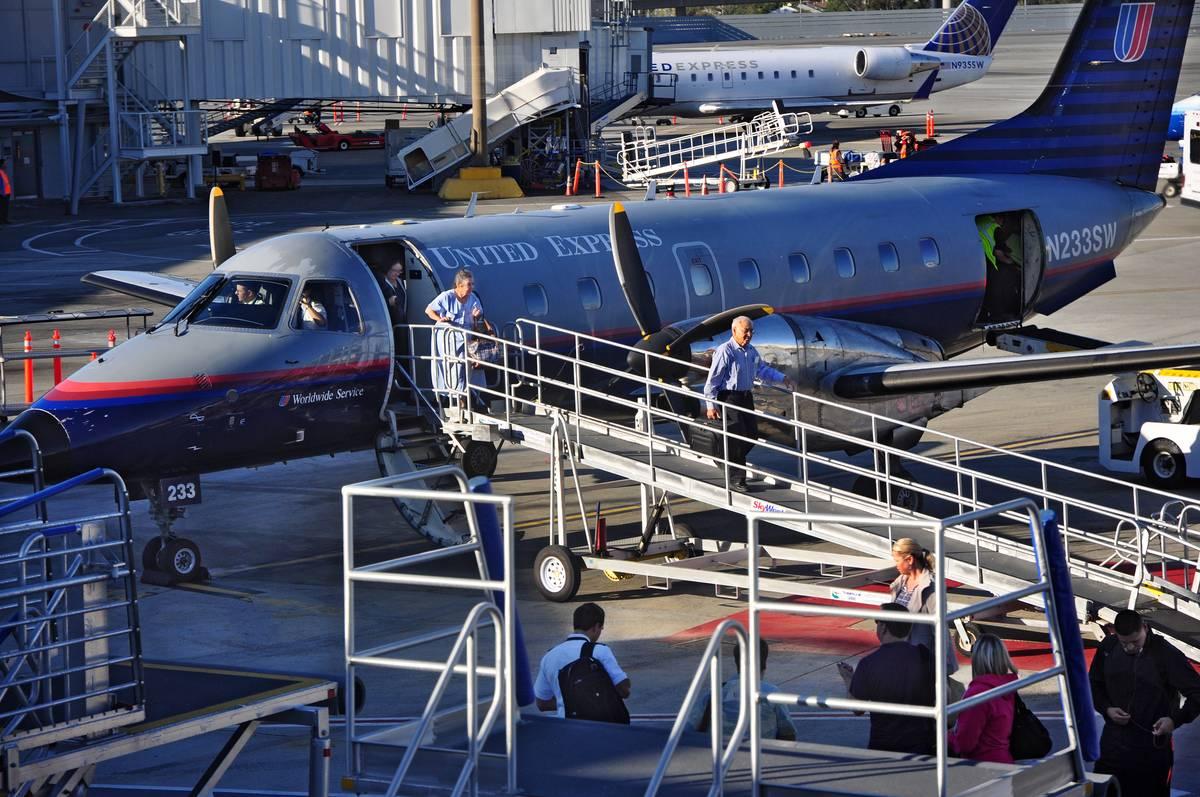 Passengers deboard an Embraer EMB-120ER Brasilia.