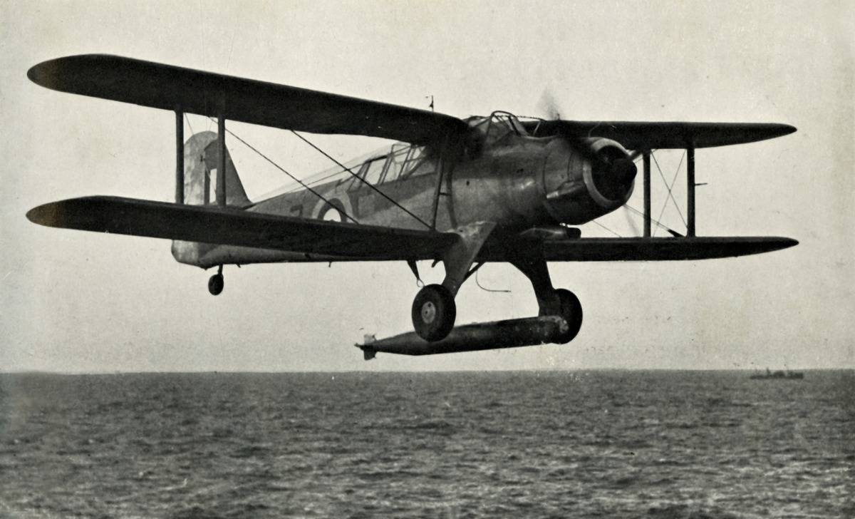 A Fairey Albacore flies over the ocean.