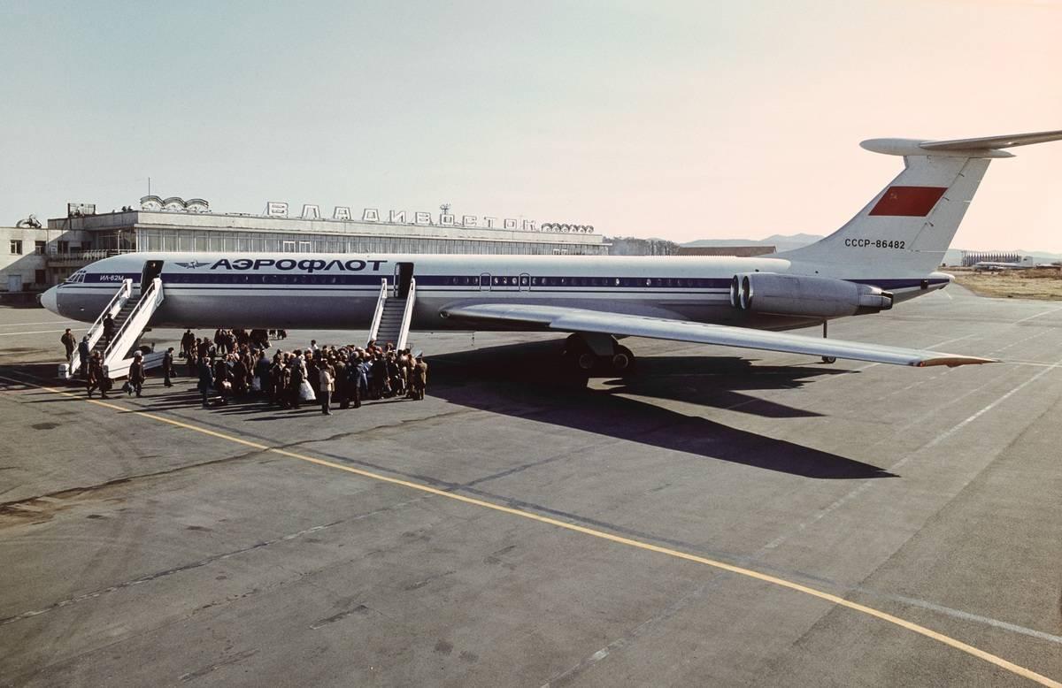 Passengers board a Ilyushin Il-62.
