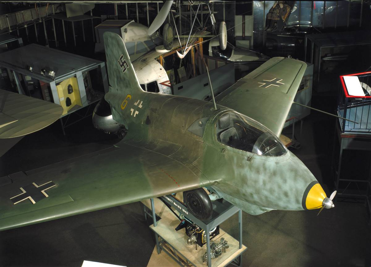 The Messerschmitt Me 163 Komet is on display at a museum.