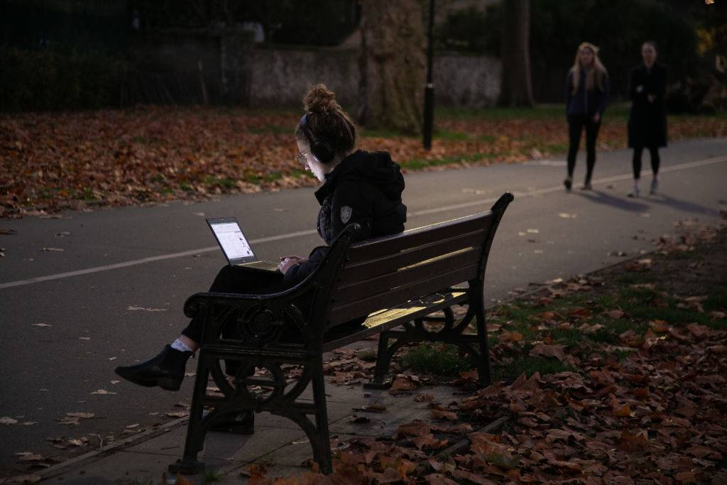 Woman in a park on her computer