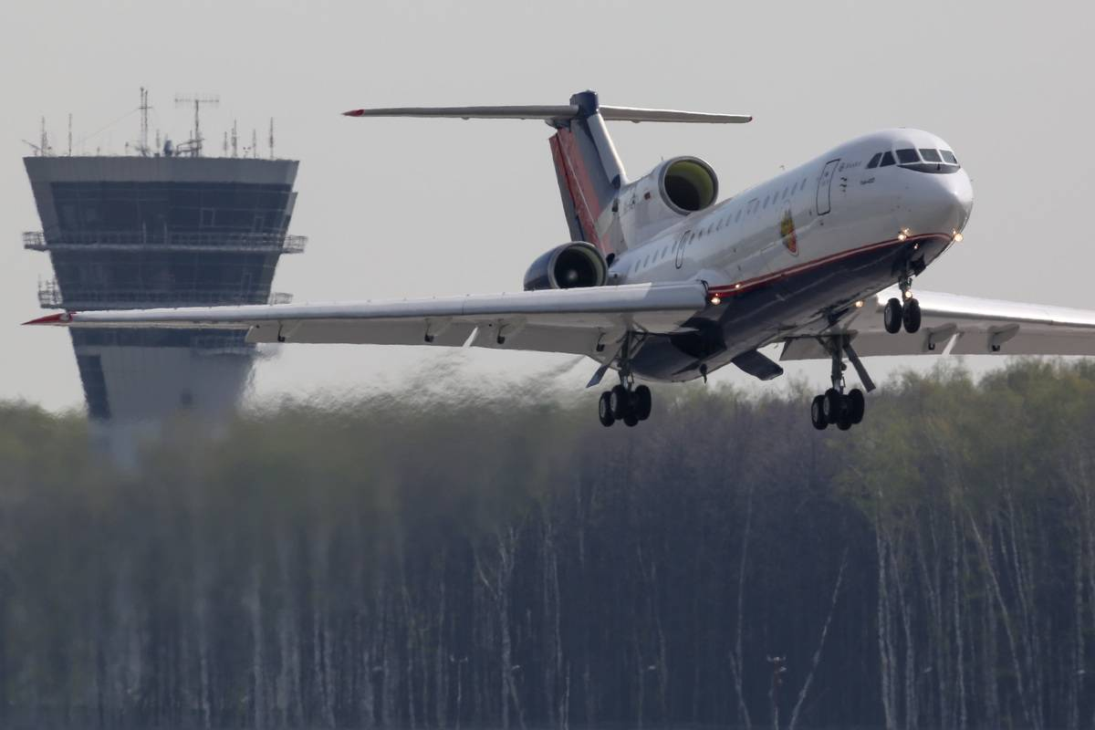 The Yakovlev Yak-42 takes off from an airport.