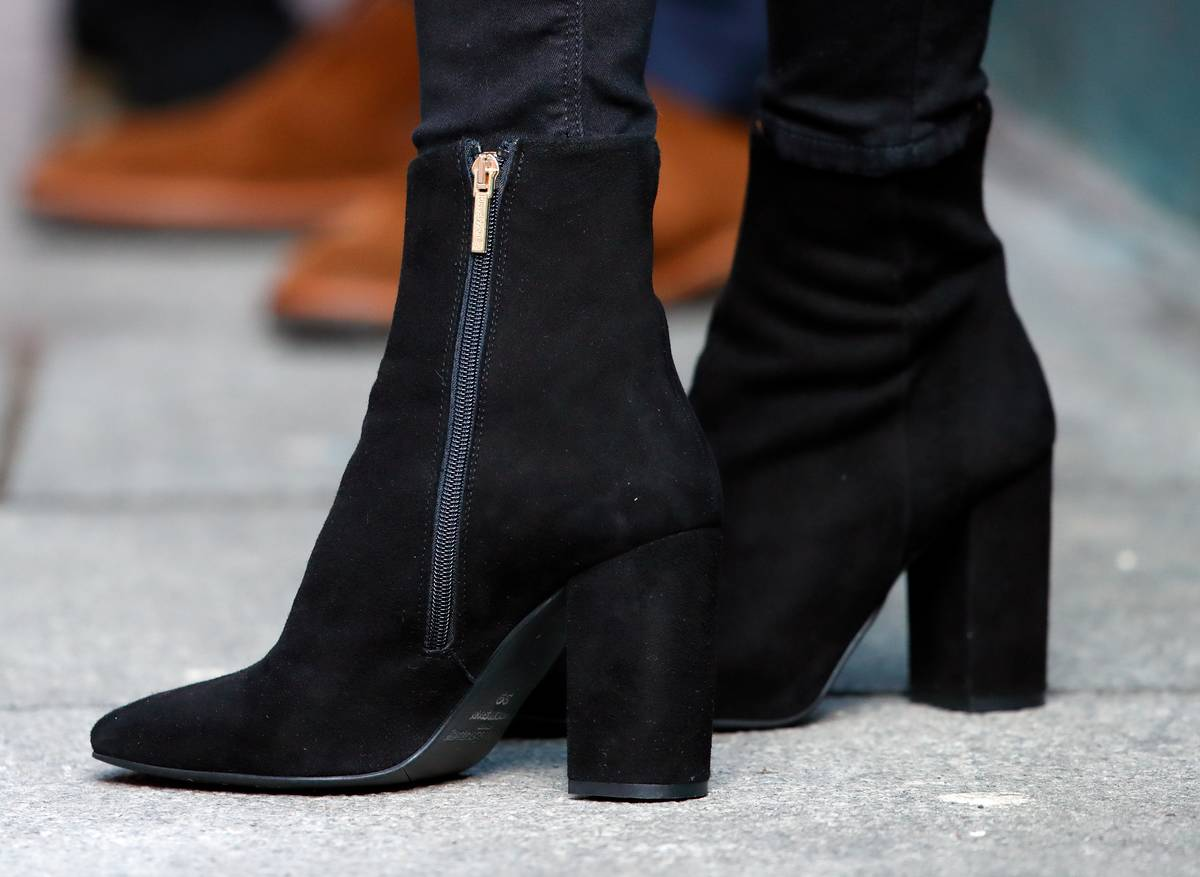 A close-up shows black boots that Kate Middleton wore while visiting the National Centre for Youth Mental Health in Ireland, 2020.