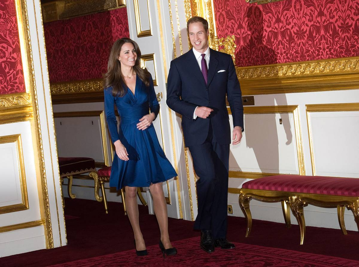 Prince William and Kate Middleton arrive to announce their engagement to the press.