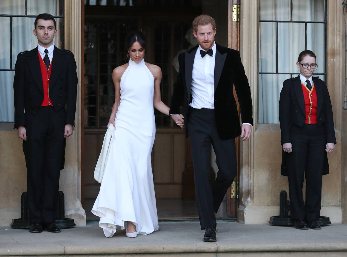 Meghan Markle and Prince Harry leave their wedding to attend the celebrations.