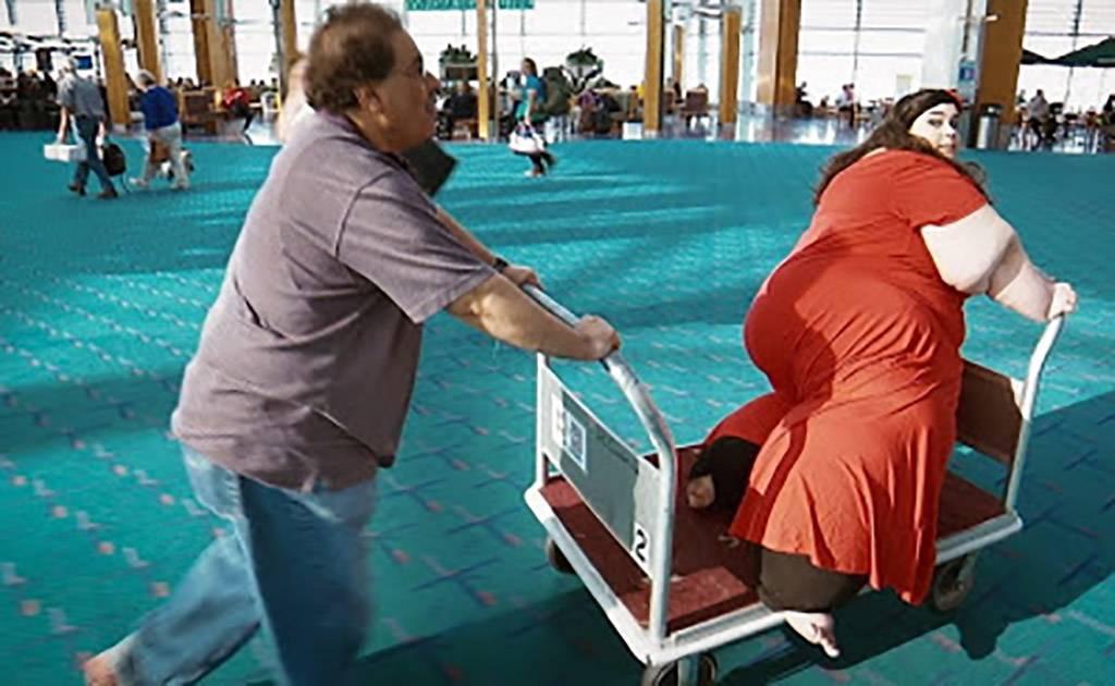 Man pushing woman