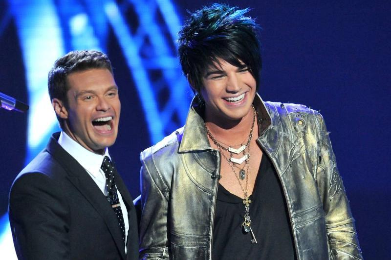 Adam Lambert and Ryan Seacrest shake hands on stage during American Idol Season 8.