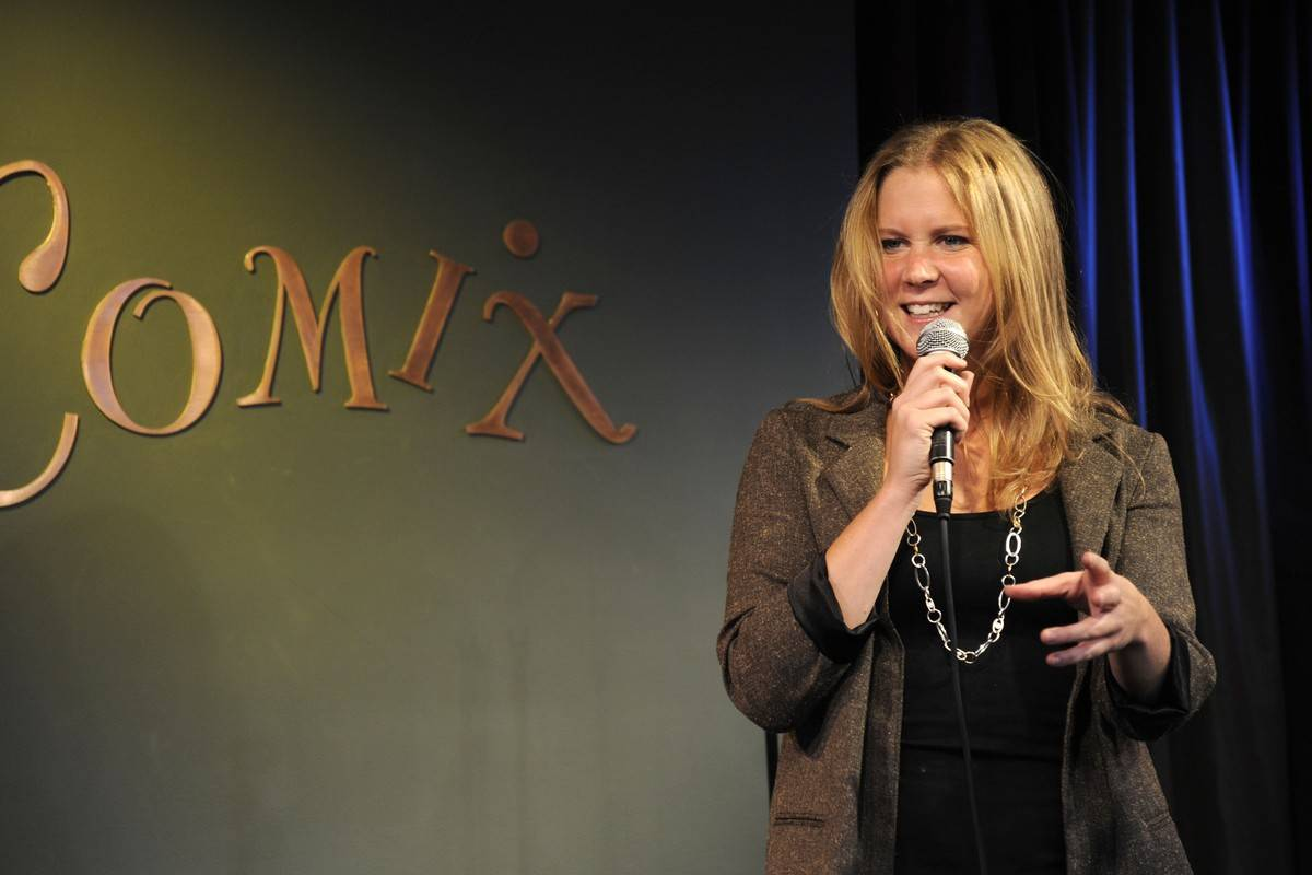 Amy Schumer performs onstage.