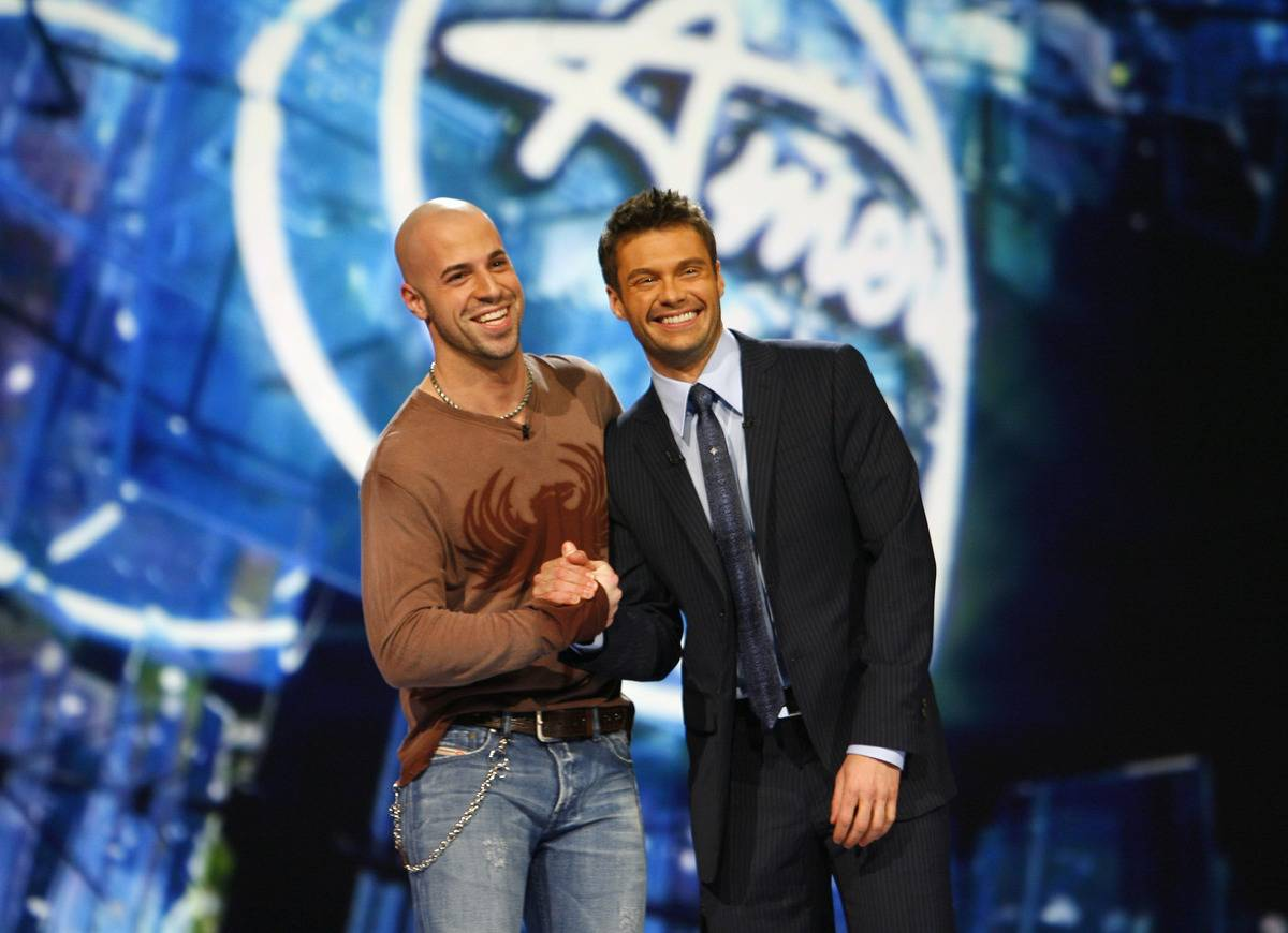 Chris Daughtry shakes hands with Ryan Seacrest on the American Idol stage.