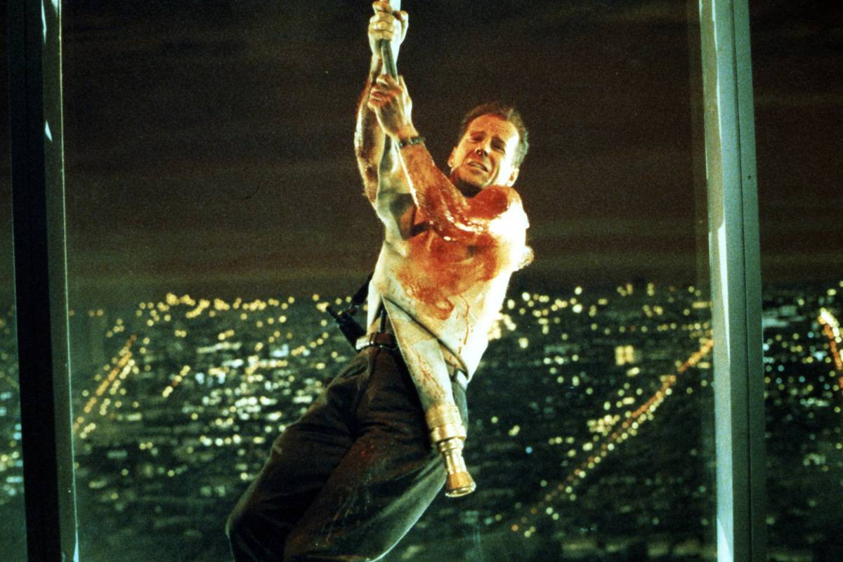 bruce willis swinging from a rope in die hard