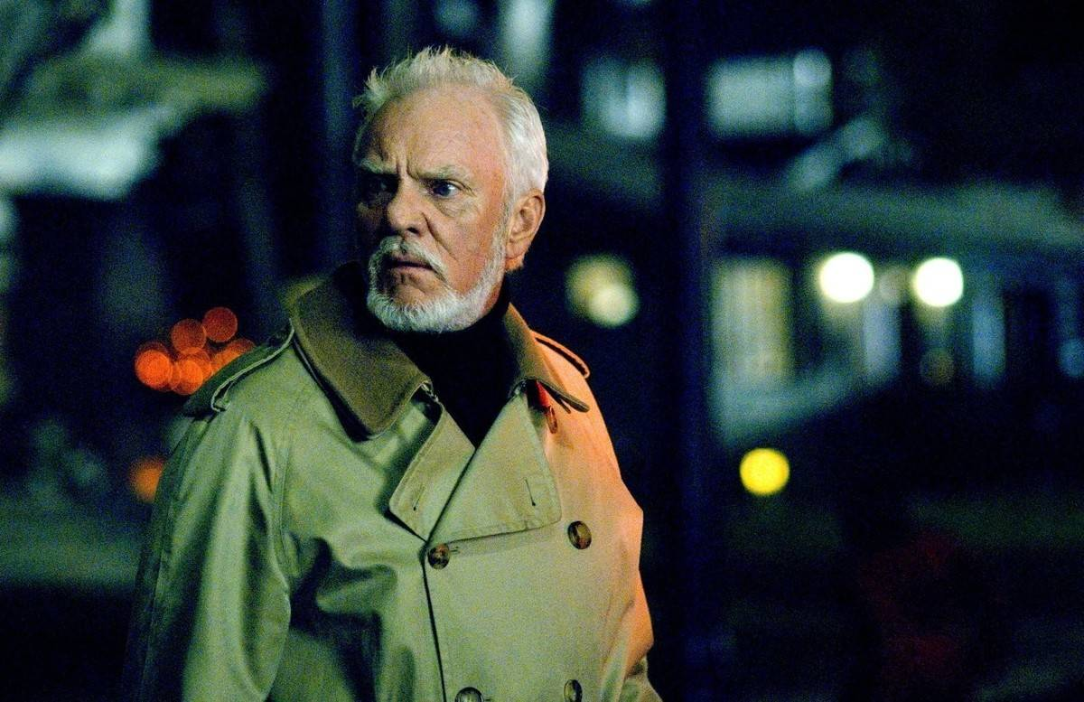 Malcolm McDowell wearing a trench coat in halloween