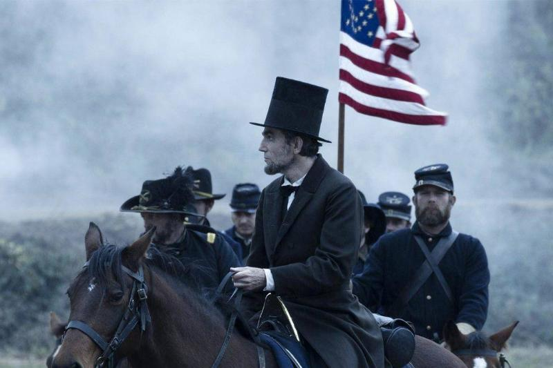 Daniel Day-Lewis as Abraham Lincoln riding a horse during the Civil War