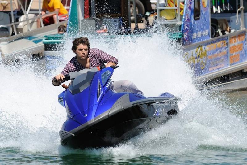 Adam Scott riding a jet ski in piranha