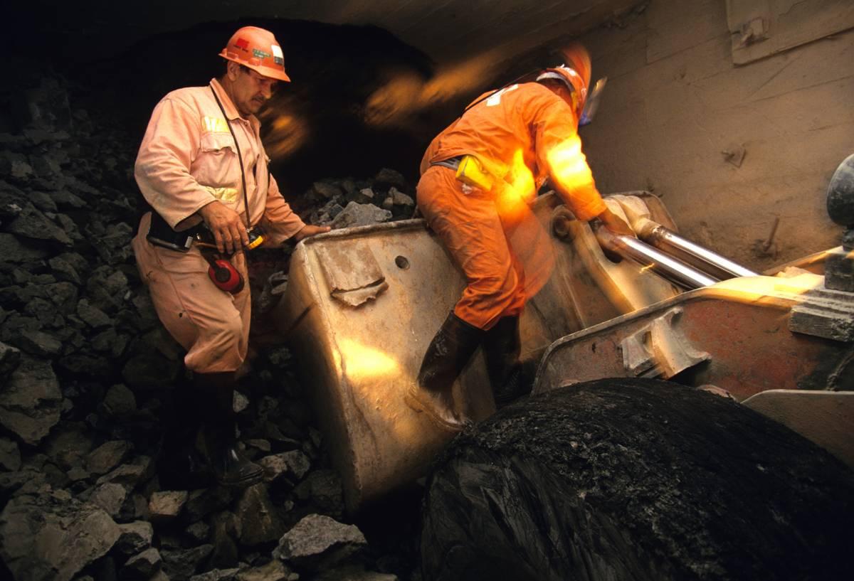 Miners search the Premier Cullinan Mine for diamonds.