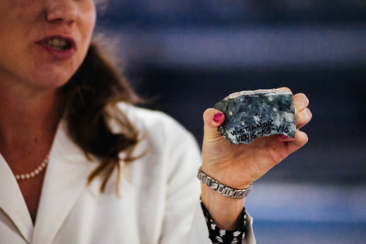 A laboratory scientist holds kimberlite, which contains diamonds.