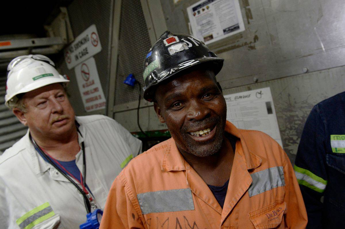 Miners from South Africa descend into the Cullinan Mine.
