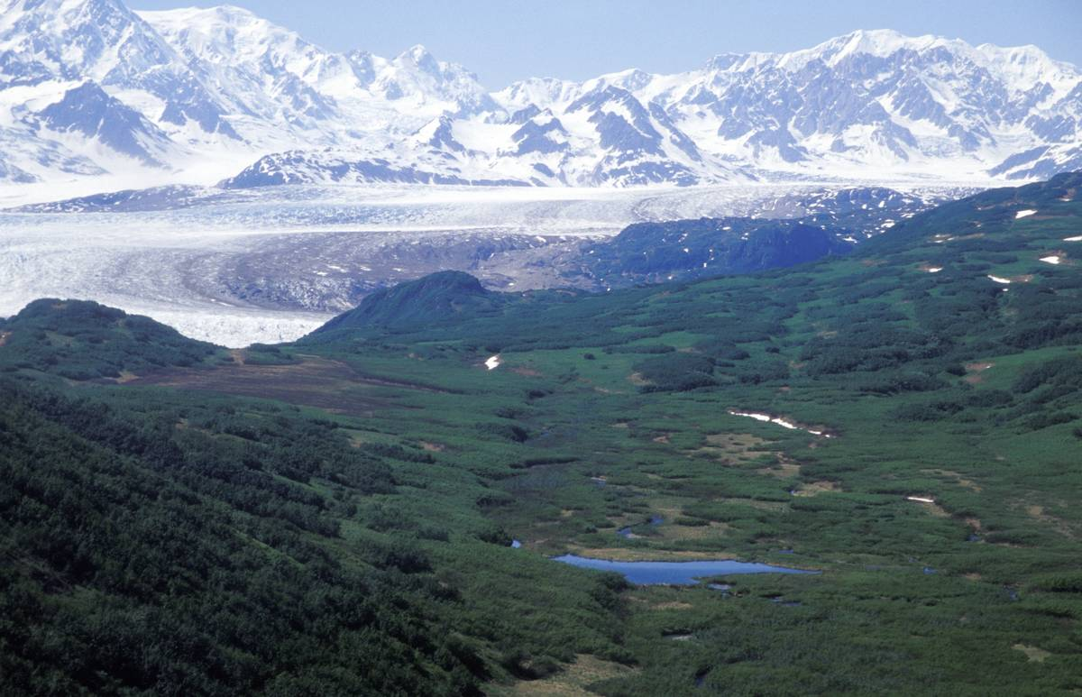 A view of The Triumvirate Glacier in Alaska is from a helicopter.