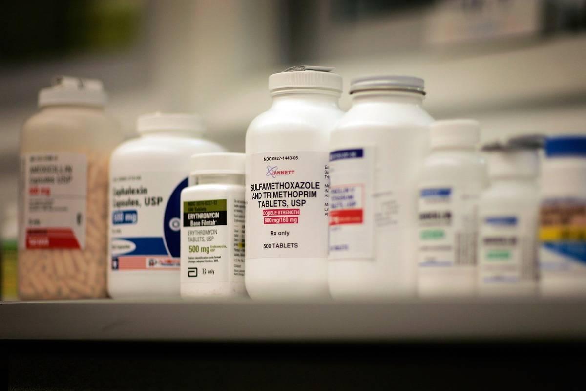 Jars of antibiotics line pharmacy shelves.