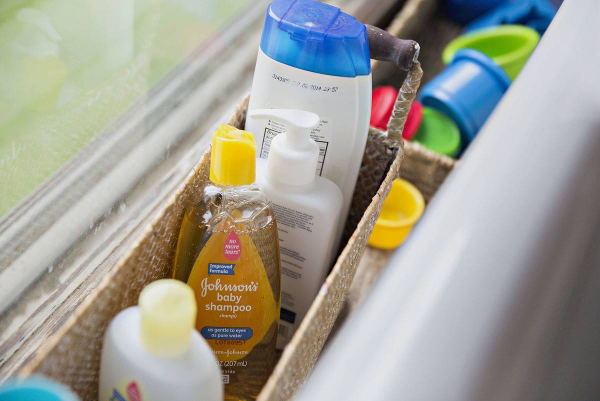 A variety of Johnson's hair care products are arranged in a basket.