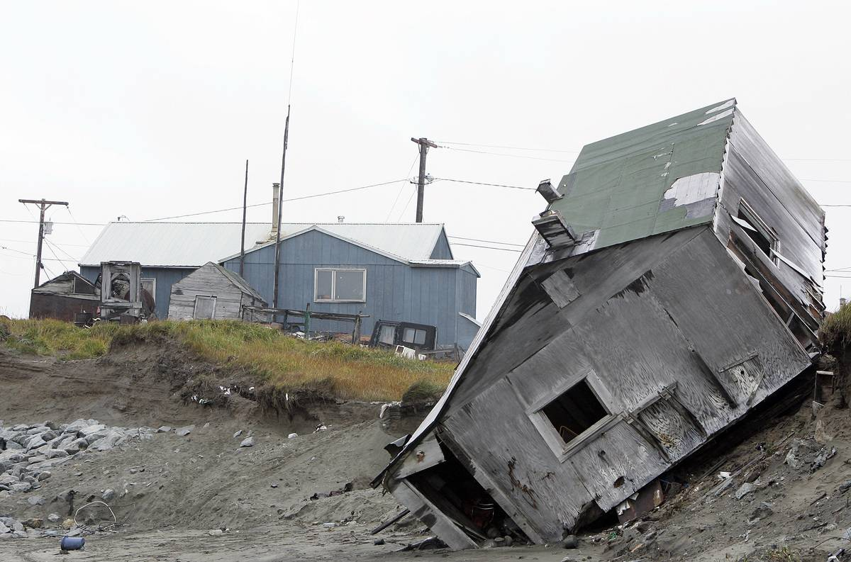An Alaskan house is toppled over due to erosion from melting permafrost.