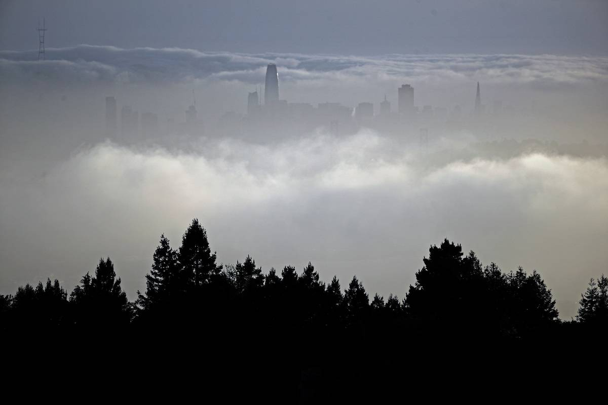 A change in the weather is on it's way with fog rolling in to obscure the San Francisco skyline as seen from the hills in Oakland Calif. on Mon. April 23, 2018.